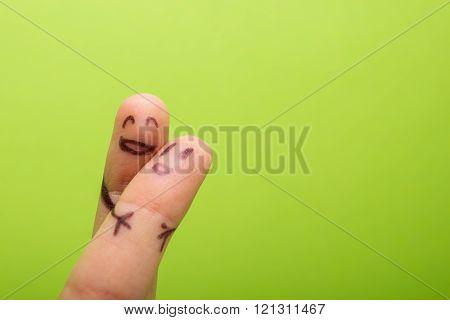Funny finger holding blank bunner and smiling