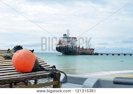 tanker ship at pier Caribbean Sea Picnic Center beach Big Corn Island Nicaragua Central America