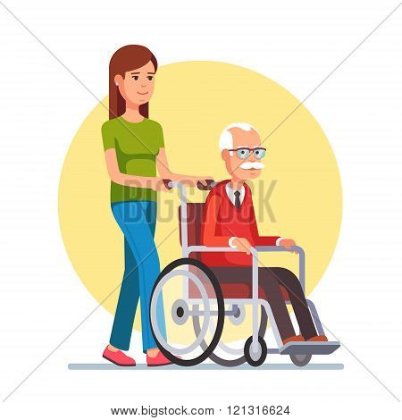 Woman strolling with elder man in wheelchair
