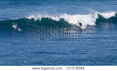 Surfers Ride The Waves In Australia