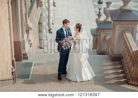 Newlyweds Standing On The Stairs