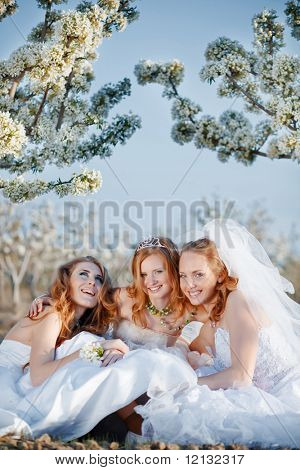 Three happy beautiful brides together
