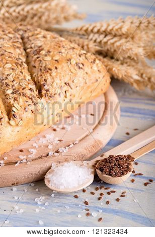 Two Spoons With Linseeds And Salt Next To Bread