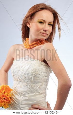Portrait of bride with windy hair on blue background