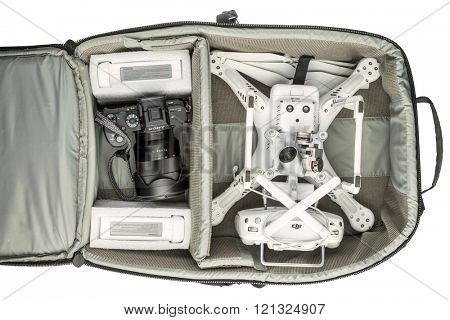 Fort Collins, CO, USA - March 09, 2016:  Photographer's backpack with DJI Phantom 3 quadcopter drone,  a set of propellers, radio controller, and spare batteries and Sony A7r mark 2 mirrorless camera.