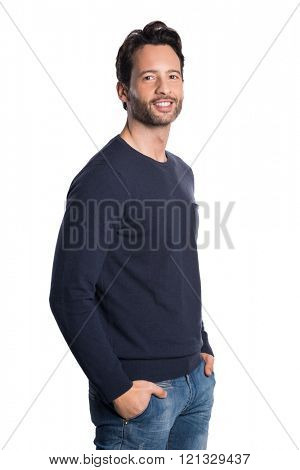 Handsome casual man smiling isolated on white background. Portrait of a happy smiling young man isolated on white background. Satisfied and proud latin guy looking at camera with hands in pocket.
