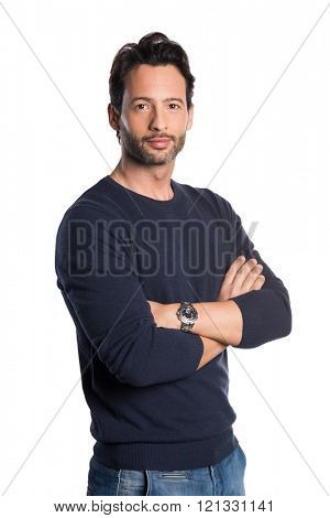 Casual young man looking at camera with arms crossed and satisfaction. Happy proud man isolated on white background. Handsome smiling guy isolated over white background.
