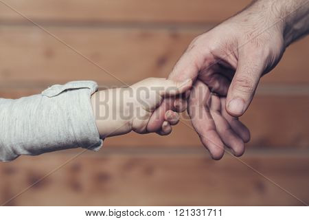 Hands Of Son And Father