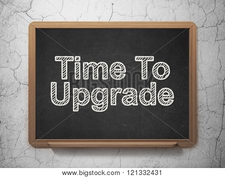 Time concept: Time To Upgrade on chalkboard background