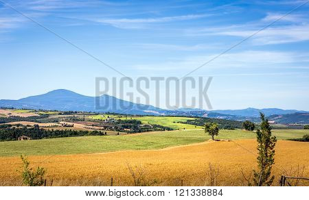PIENZA, ITALY - JUNE 26, 2015: Summer Tuscan scenery near old Pienza town