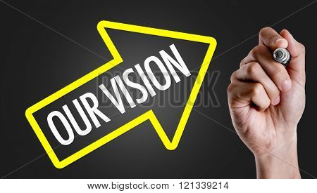 Hand writing the text: Our Vision