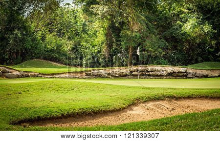 PLAYA DEL CARMEN, MEXICO - MARCH 25, 2014: Beautiful golf course and golfcart on mayan riviera in Mexico