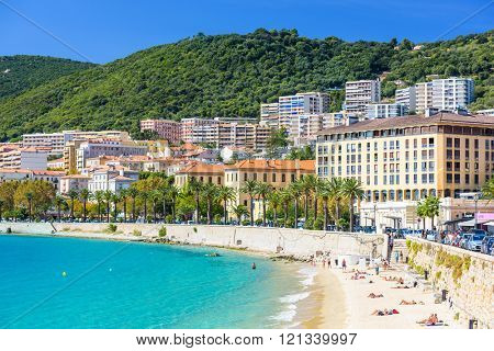AJACCIO, FRANCE - OCTOBER 29, 2014: Beachgoers enjoy the water in the Town of Ajaccio on the west coast of the Island of Corsica.