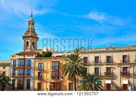 Valencia Plaza de la Reina square and Santa Catalina Church tower at Spain