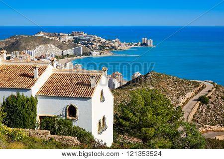 Cullera beach aerial with skyline of village in Mediterranean Valencia of Spain