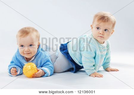 Studio portrait of two little children twins