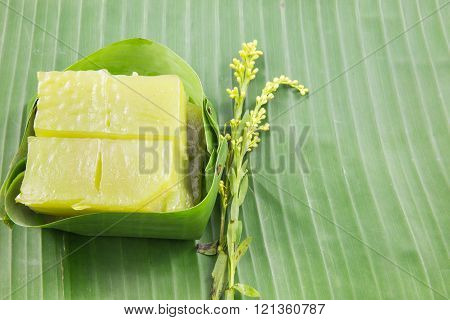 Kind of Thai sweetmeat, Multi Layer Sweet Cake (Kanom Chan) on banana leaf with flower