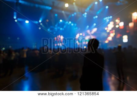 Silhouette concert in front of stage