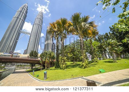 KUALA LUMPUR MALAYSIA - JANUARY 10 2016: KLCC park which contains the Petronas Towers and luxury hotels and shopping mall in Kuala Lumpur