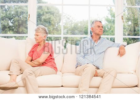 Senior couple not speaking after an argument on the sofa