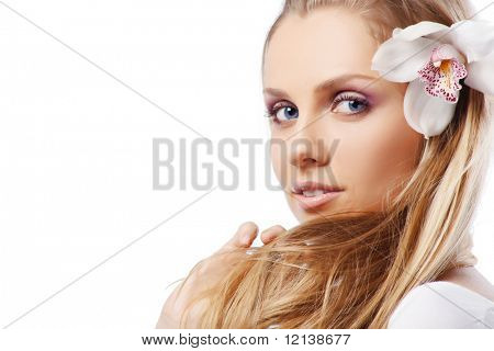 Portrait of very beautiful woman with orchid in her hair