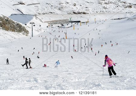 People Skiing In European Alps.