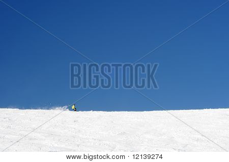 One Person Skiing In Vast Slopes Of European Alps.