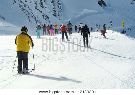 Many People Skiing In European Alps.