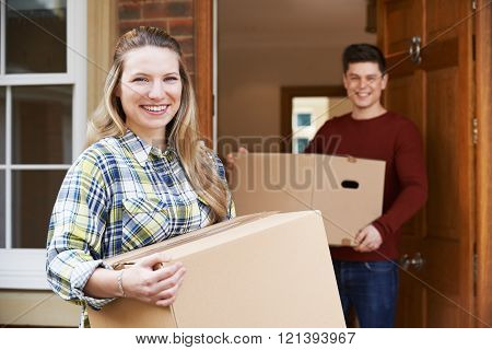 Young Couple Moving In To New Home Together