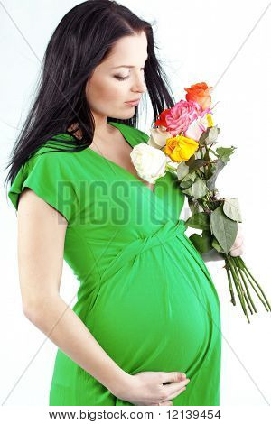 Portrait of pregnant woman with rose