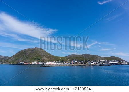 View from sea to Honningsvag with blue sky