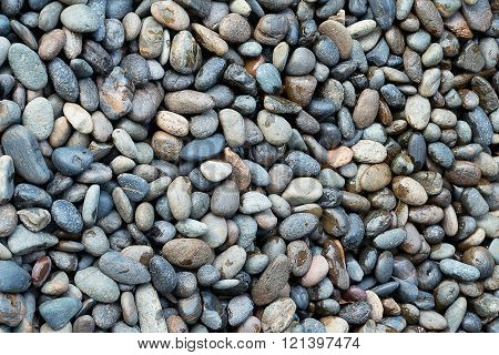 Background Pattern Naturally Polished River Rock Pebbles Background.