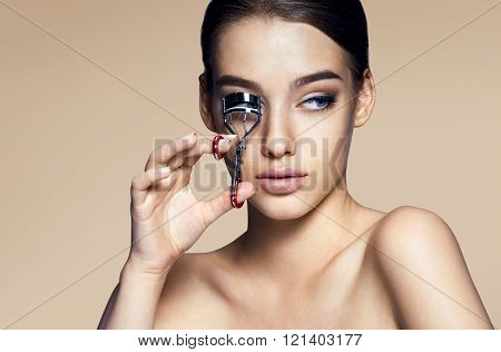 Beauty woman with clip for eyelashes