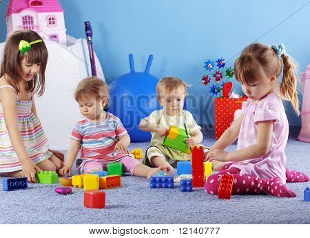 Group of kids playing with constructor
