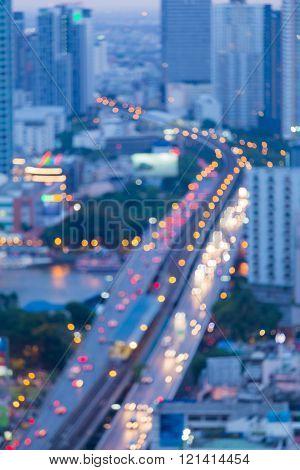 Blurred bokeh lights abstract background, bridge cross over Bangkok main river