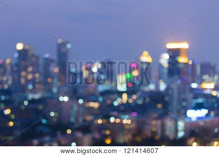 Night view blurred bokeh lights city downtown, abstract background