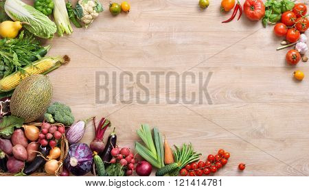 Huge Group Of Fresh Vegetables And Fruits On A Wooden Background.