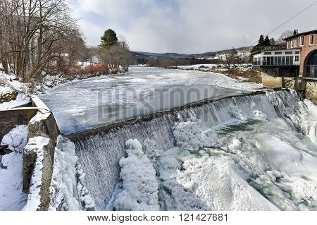 Dewey's Mills Hydroelectric Power Plant along the Quechee River in Vermont during the winter.