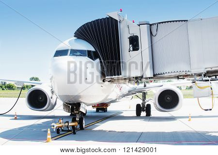 Airplane ready for boarding in airport hub.