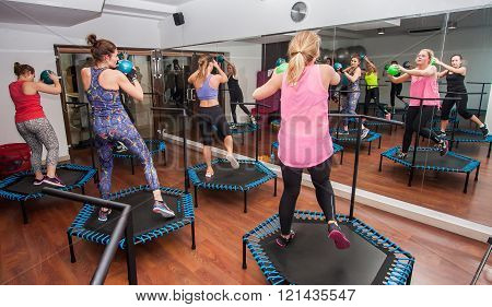 Otwock Poland - November 22 2015: Women practicing with balls on the trampolines