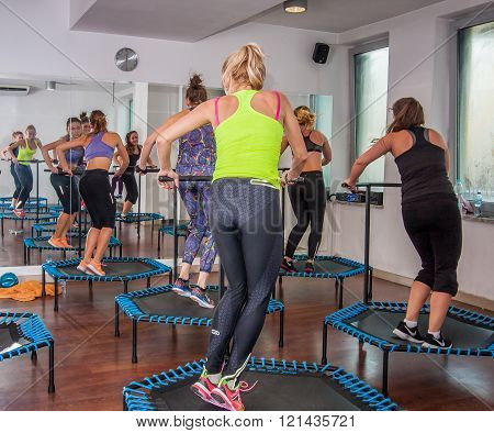 Otwock Poland - November 22 2015: Fitness women jumping on small trampolines