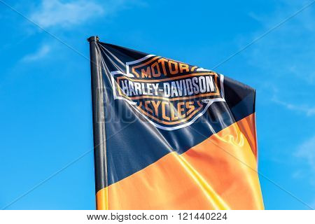 Flag With Emblem Of A Motorcycle Harley Davidson Closeup
