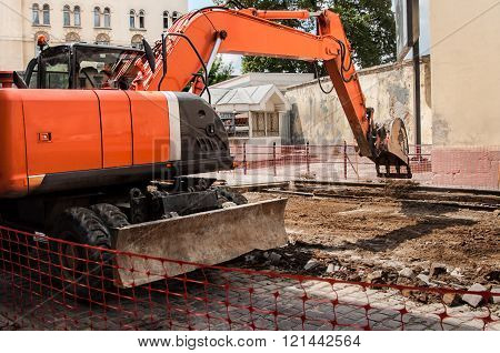 Excavator On The Street Constriction
