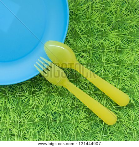 Fun Colored Background With Spoons, Forks , Dish On Green Grass #2