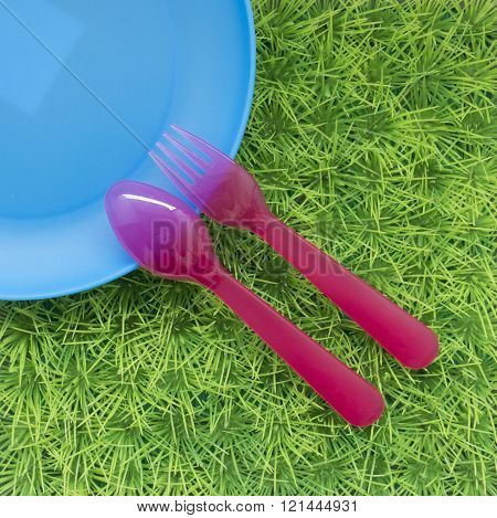 Fun Colored Background With Spoons, Forks , Dish On Green Grass #4