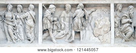 BOLOGNA, ITALY - JUNE 04: Jesus accompanies the journey of the disciples by Zaccaria da Volterra, door of San Petronio Basilica in Bologna, Italy, on June 04, 2015