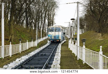 Kiev, Ukraine - March 8, 2016: White Funicular Train Coming Down With Passengers