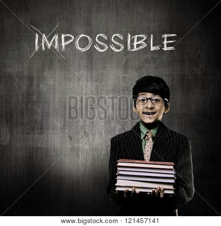 Genius Little Boy Holding Books Wearing Glasses, Making Impossible Possible