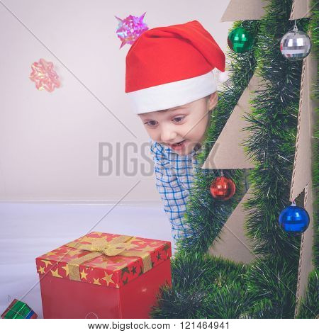 Happy Little Smiling Boy With Christmas Hat.