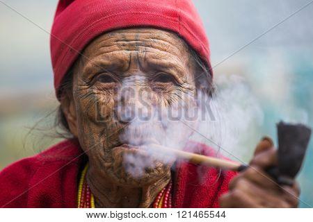 Chin tribe tattooed faced woman (Muun)